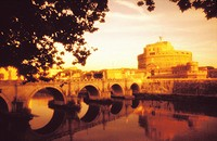 Italy Rome view of Castel Sant Angelo the Tiber River and Ponte Sant Angelo in warm grainy tones