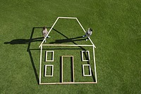 Couple building house outline