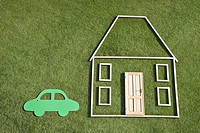 Outline of house and car in grass