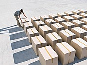 Man arranging boxes
