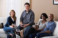 Portrait of friends with wine