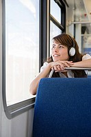 Woman listening to music on train (thumbnail)