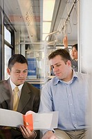 Men looking at file on train