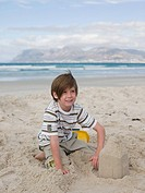 Boy with sandcastle