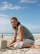 Woman making sandcastle