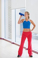 Woman with water bottle (thumbnail)