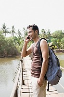 Man on bridge on cellphone