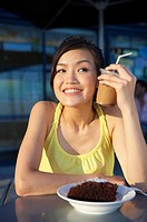 Young Lady Holding Cold Drink Against Face , Looking Away (thumbnail)