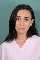 Portrait of young adult nurse sad