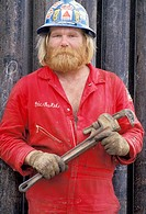 Burly Workman Holding A Wrench