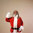 African American Santa Claus waving and laughing