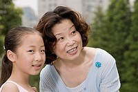 Close_up of a mature woman smiling with her granddaughter
