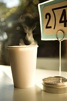 Steam rising from paper cup, close_up