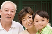 Close_up of a boy with his grandparents