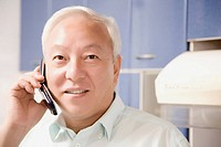 Close_up of a mature man talking on a mobile phone