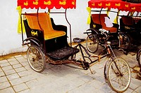 Pedicabs in front of a wall, Qufu, Shandong Province, China