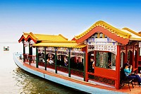 Tourists in a tourboat, Kunming Lake, Summer Palace, Beijing, China