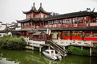 Motorboat near a building, Nanjing, Jiangsu Province, China