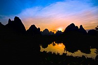 Silhouette of hills at dawn, Guilin Hills, Li River, Yangshuo, Guangxi Province, China