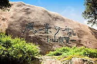 Low angle view of Chinese script on a rock formation, Huangshan, Anhui province, China