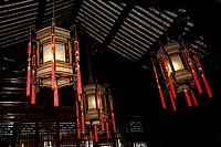 Low angle view of Chinese lanterns lit up in a building, Yu Yuan Gardens, Shanghai, China