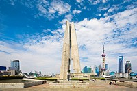 Low angle view of a museum with a tower in the background, Shanghai Monument to People's Heroes (thumbnail)