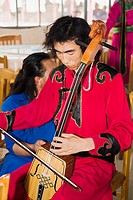 Mid adult man playing a Morin khuur, Inner Mongolia, China