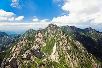 Clouds over a mountain range, Huangshan, Anhui province, China (thumbnail)