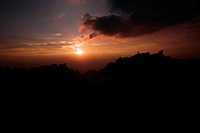 Sunset over a mountain, Huangshan Mountains, Anhui Province, China
