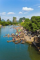 High angle view of wooden rafts at a riverbank with a hill range in the background, Guilin Hills, XingPing, Yangshuo, Guangxi Province, China