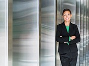 Mixed race businesswoman posing in lobby
