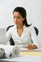 Female Asian architect working at desk