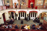 England _ London _ Soho district _ Covent Garden Market _ people at restaurant _ elevated view