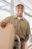 Mixed race delivery man delivering boxes