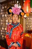China _ Beijing PÚkin _ Qianmen district street _ Young woman dressed in a traditional costume