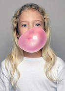 Portrait of girl blowing chewing gum