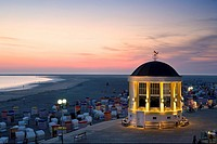 Pavilion and hooded beach chairs on beach at dusk, Borkum, Lower Saxony, Germany