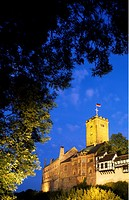 Castle lit up at dusk, Wartburg Castle, Eisenach, Thuringia, Germany
