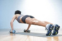 Woman doing push_ups in gym