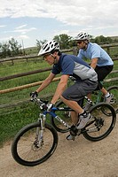 Two male cyclists in rural landscape