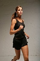 Young woman jogging indoors