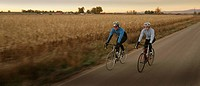 Two cyclists on road in countryside