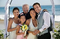 Bride and Groom with family at beach wedding portrait