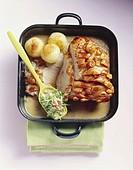 Roast pork with crackling, dumplings and salad