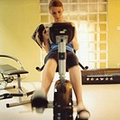 young woman, exercise bike