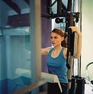 young woman, gym, pectoral machine