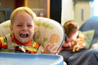 child crying on a high chair