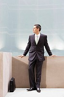 Businessman leaning on wall portrait
