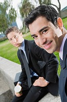 Portrait of two businessmen smiling