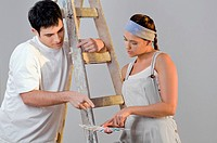 Close_up of a young couple choosing color from a color swatch